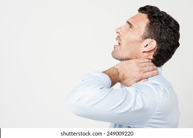 Male having a neck pain isolated over white
