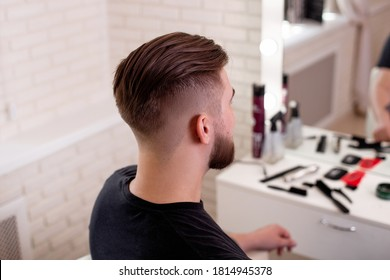 Male head with stylish haircut on barbershop background