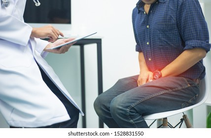 Male health concepts. The young man with pain consulted a doctor for treatment. The doctor is interviewing and advising the patients.