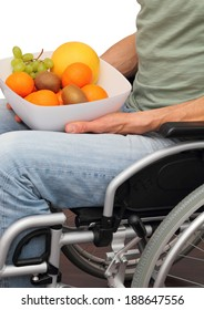 A male healthy Wheelchair user with a fruit bowl