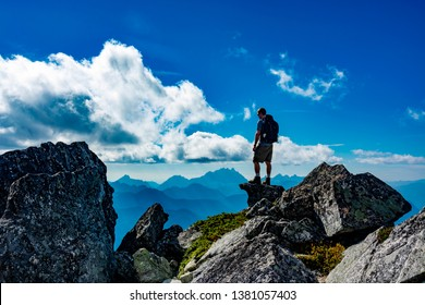 Male hiker on top of Mount Pugh