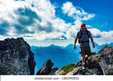Male hiker on top of Mount Pugh