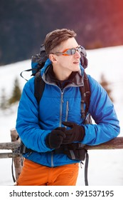 Male hiker passing winter mountains. Concept of success living and free traveling, active leisure, health care and well being.