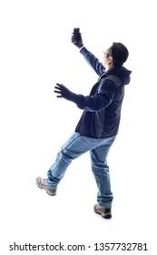 Male hiker or tourist doing a selfie and falling backwards.  Isolated on a white background for composites or copyspace.