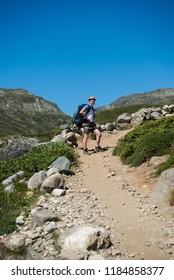 male hiker walking on Besseggen ridge in Jotunheimen National Park, Norway