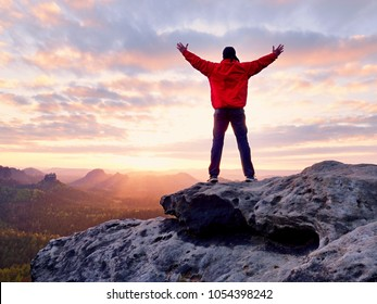 Male hiker walking on top of mountain looking at beauty morning landscape.  Man hiking silhouette