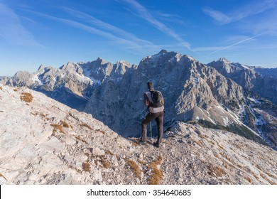 Male hiker walking to the top of the mountain