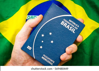 Male holding hand in Brazilian passport