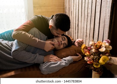 Male homosexual kiss on the bed