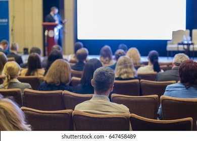 Male Host Speakers Standing in Front of the Audience During the Conference. Horizontal Image Composition