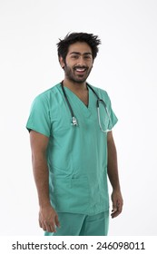 Male Indian doctor wearing a Green Scrubs & a stethoscope. Isolated on white background.