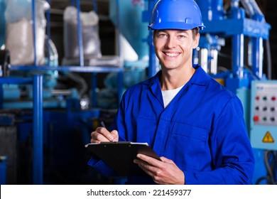 male industrial technician working inside a factory
