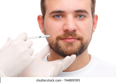 The male is injected with botox on the cheek near the mouth. Isolated over white background.
