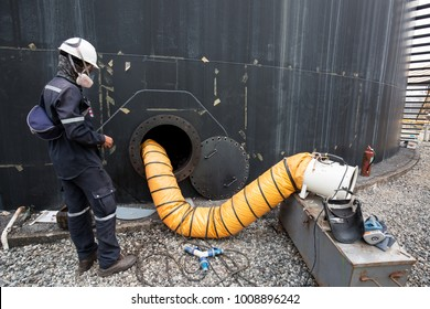 Male into the black fuel tank oil area confined space safety blower fresh air