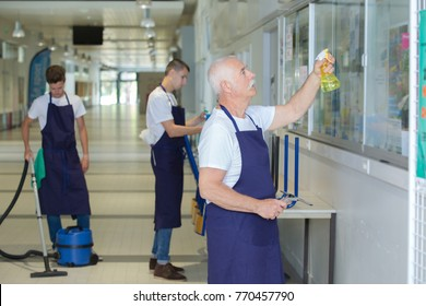 male janitorial staff cleaning the establishment