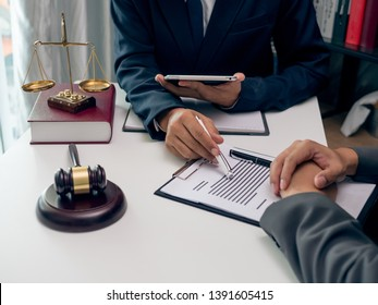 Male lawyer or judge consult having team meeting with client, Law and Legal services concept..