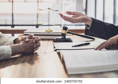 Male lawyer or judge consult having team meeting with Businesswoman client, Law and Legal services concept.