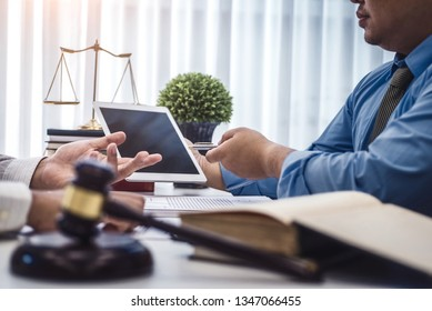 Male lawyer show tablet for  explain a contract agreement to client for law .Law and Legal services concept.