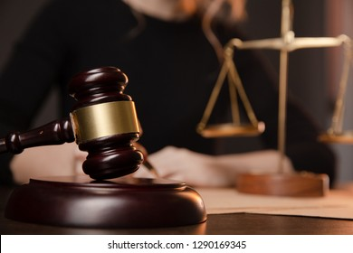 Male lawyer working with contract papers and wooden gavel on tabel in courtroom. justice and law ,attorney, court judge,