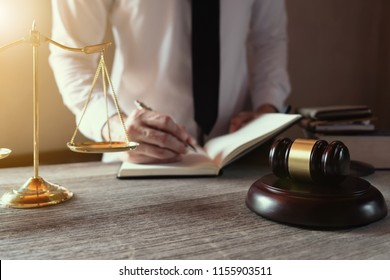 Male lawyer working with lawsuit papers on tabel in courtroom. justice process and law, attorney, court judge, concept.