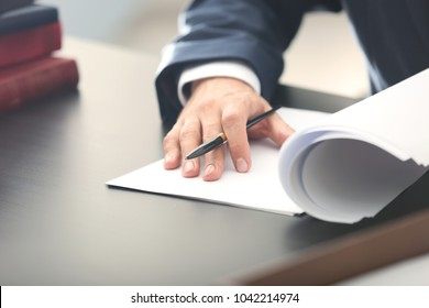 Male lawyer working in office, closeup
