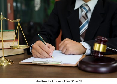 The male lawyer is working on the document for the lawsuit against the client. Legal Lawyer Concepts.