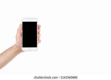 Male  in left hand holding smartphone with blank screen on white background