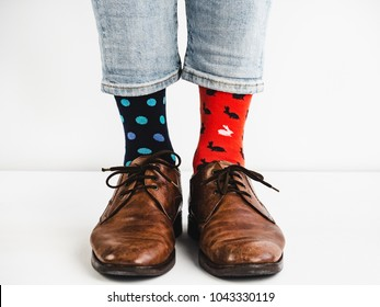 Male legs in bright, colorful socks and stylish, vintage shoes on a white background. Lifestyle, fashion, fun