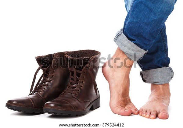 Male legs and leather boots on white background