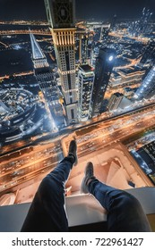 Male legs of rooftop of Millennium Plaza Hotel Dubai on Sheikh Zaid Highway, Tower, Al Yaqoub Tower, Capricorn Tower, Maze Tower, Dubai, UAE at night