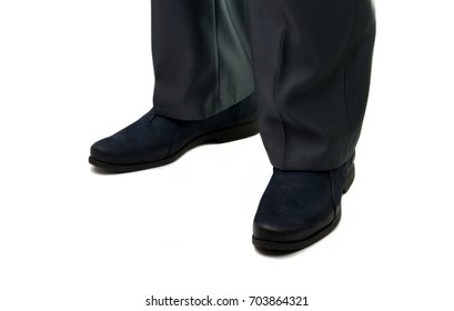 Male legs in shoes on a white background