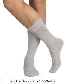 Male legs in socks. Isolated on white background.  Clipping paths included.