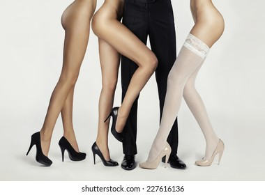Male legs surrounded by women. Conceptual fashion art photo