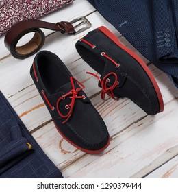 male loafers, belt and clothes on wooden background. Mens shoes