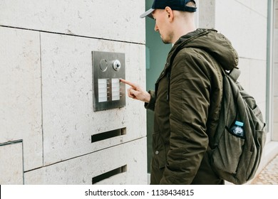 A male local resident or tourist clicks on the doorphone button or calls the intercom. Arrival and call from street to room