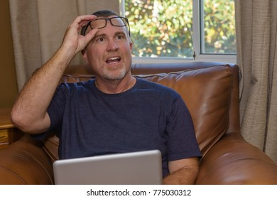 Male looking up from work to speak with someone in home office