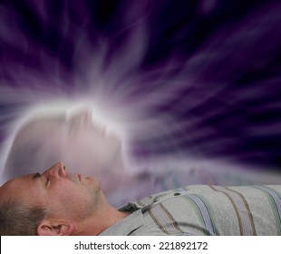 Male lying supine with eyes closed and astral projection effect on dark background