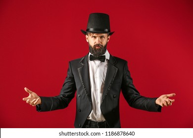 Male magician on color background