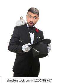 Male magician showing tricks on white background