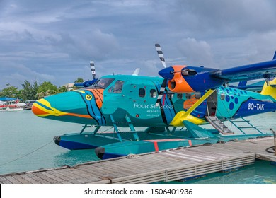 Male, Maldives - 08.17.2019: Seaplane of Trans Maldivian Airways airline is on port with overcast sky in Male. Special plane paint on seaplane, Maldives aerial transportation