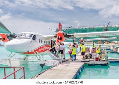 Male, Maldives - 14.08.19: Passengers are boarding seaplane at Male, Maldives. Transmaldivian airways, world largest seaplane company. Travel in Maldives