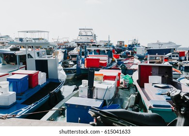 Male, Maldives - December 17, 2016: Fishing boats in the harbor in city Male, capital of Maldives