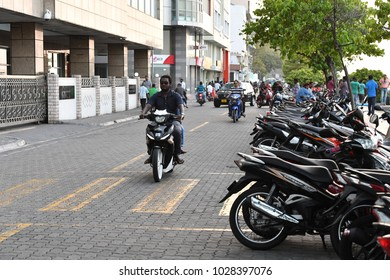 MALE, MALDIVES - FEBRUARY 17 2018 - People in the street before evening pray time in male maldives capital small island town heavy traffic jam