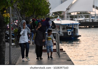 MALE, MALDIVES - FEBRUARY 17 2018 - People i in island main place before evening pray time in male maldives capital small island town