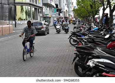 MALE, MALDIVES - MARCH, 4 2017 - People in the street before evening pray time in male maldives capital small island town heavy traffic jam