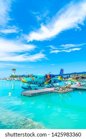 MALE, MALDIVES - MAY/20/2019: Seaplane of Trans Maldivian Airways airline is on port with blue sky in Male.