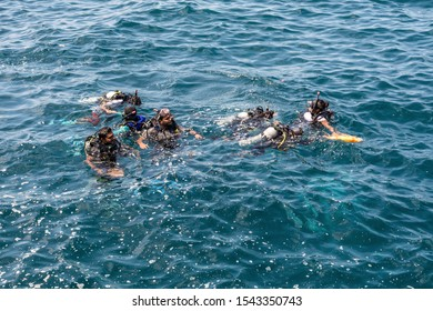 Male, Maldives - November 18, 2017: Instructor and students during scuba diving lessons in Male, Maldives, Indian Ocean.