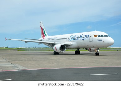 MALE, MALDIVES - SEPTEMBER 4, 2014: A SriLankan Airlines Airbus A320 at Ibrahim Nasir International Airport. SriLankan Airlines is the flag carrier of Sri Lanka.