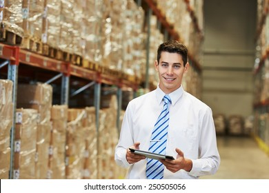 male manager man worker standing in big modern warehouse with tablet computer