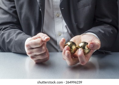 male manager with metallic anti-stress balls in his hands on the workplace